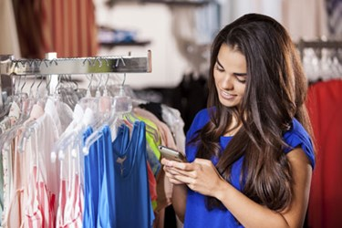 375_250-woman_shopping_on_phone_in_store_mobile